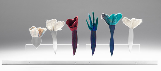 Lisa VERSHBOW Corsages, six brooches on a stand, Silver, Copper with color pencil patina and wet-felted wool Installation – 21 x 67 x 3 cm, (each brooch approx. 14 x 3 x 1 cm), 2013