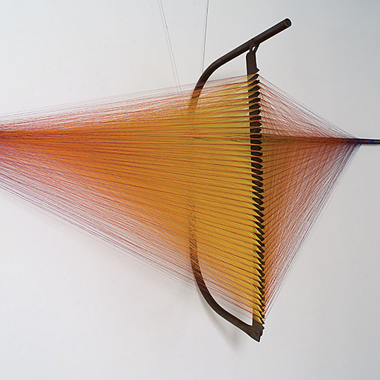"1rw SAW PIECE NO.4 (AUTUMN) Randy Walker, salvaged bucksaw, steel rod, nylon thread 42"" x 96"" x 26"", 2006, Photo by Tom Grotta"