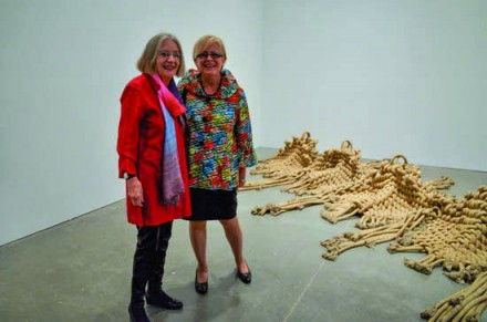 Françoise Grossen and Kathleen Mangan in front of Grossen's Inchworm sculpture at the opeing of Fiber: Sculpture 1960–present opening at the ICEA