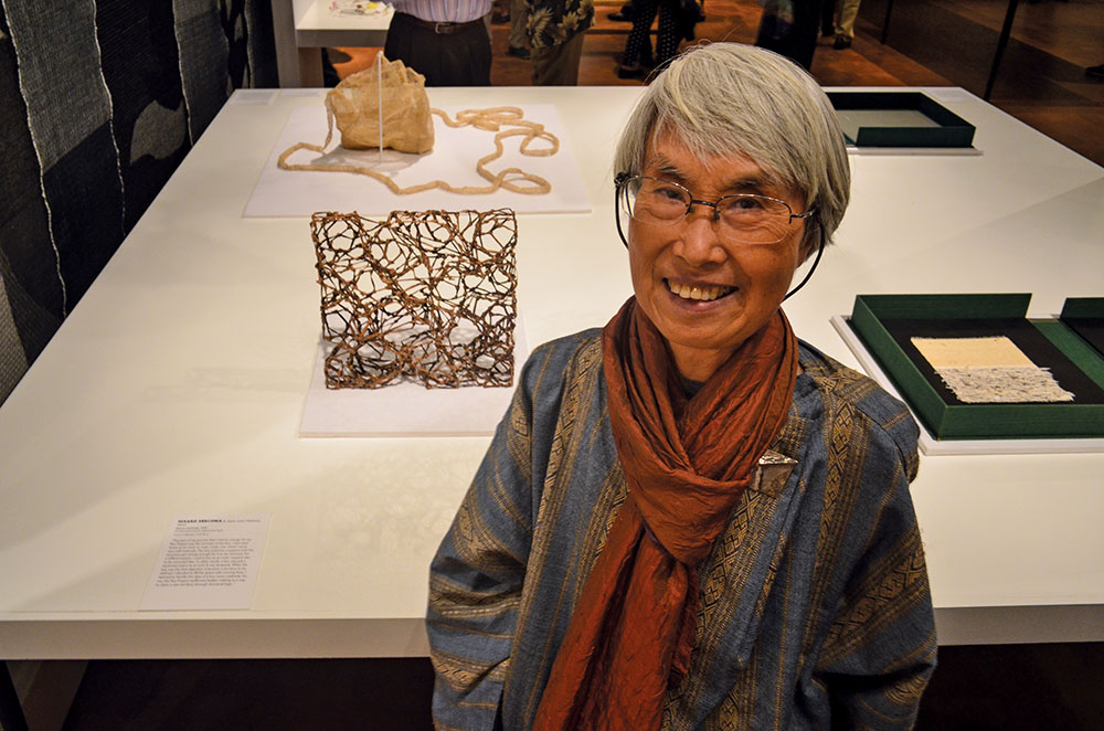 Hisako Sekijima in front of her works at The Box Project Exhibition at the Fowler Museum. Photo by Tom Grotta