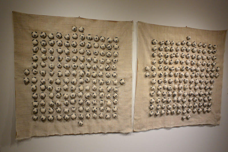 301 balls (Diptych), 2017 Cotton thread, coal from Soma, Turkey, fabric 36 × 37 in, 2017. Photo by Tom Grotta
