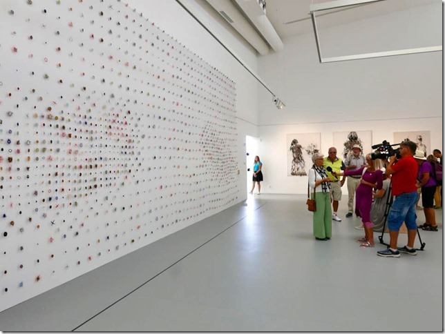 Marian Bijlenga being interviewed in front of her work, Large Sampler Dots, Photo by Simon Oud.