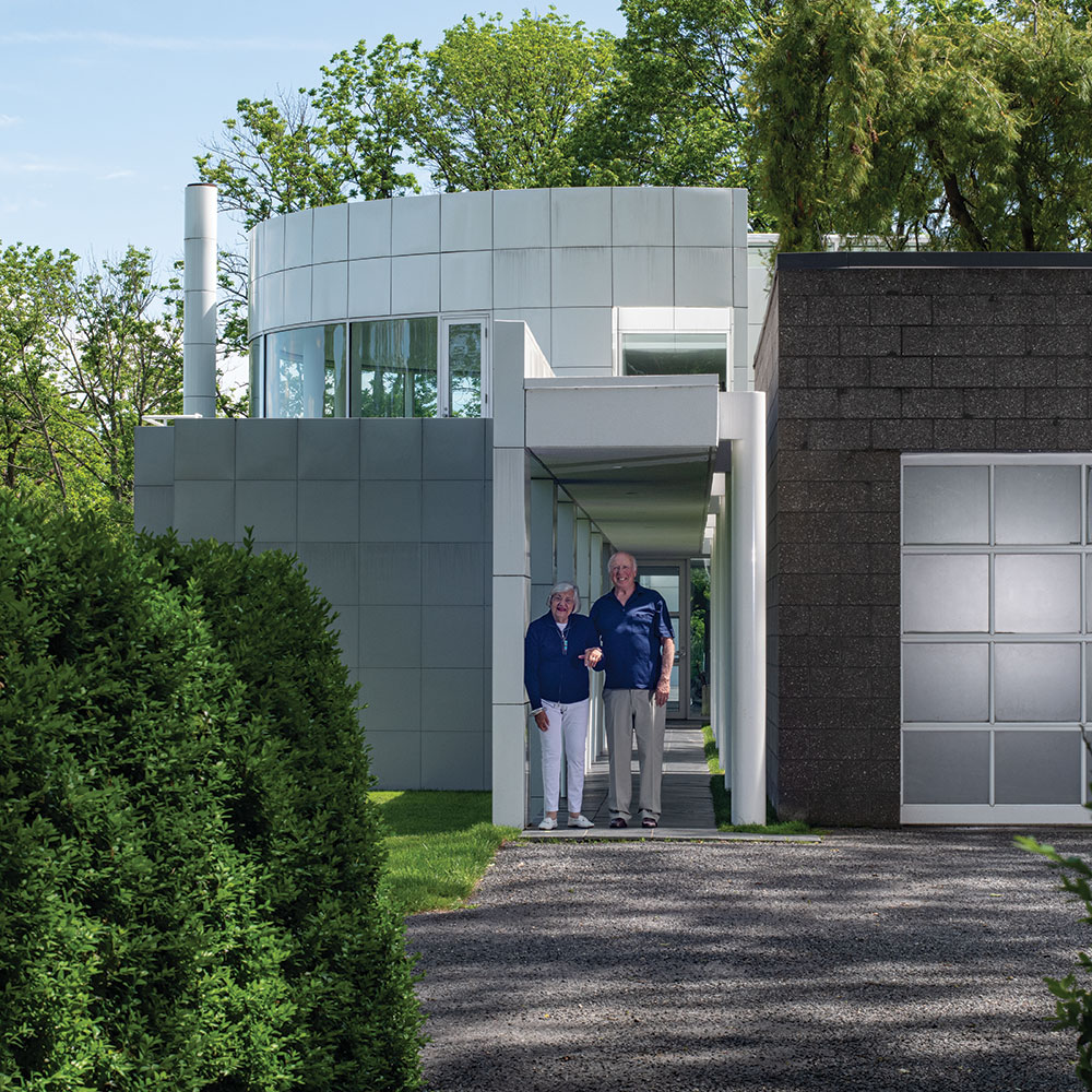 Sandy and Lou Grotta in front of the Grotta House from The Grotta Home by Richard Meier: A Marriage of Architecture and Craft published by Arnoldsche, photo by Tom Grotta