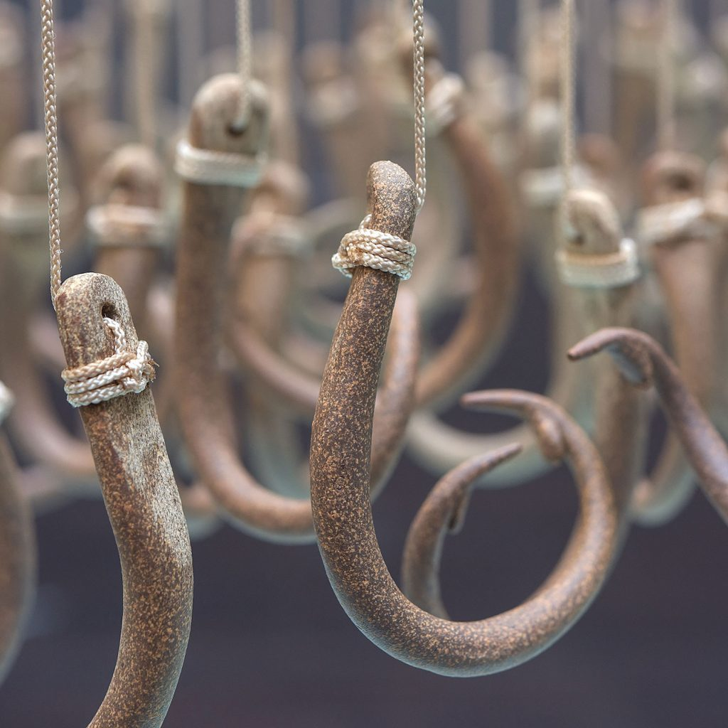 Detail of Long Lines, 132 suspended Ceramic hooks by Annette Bellamy