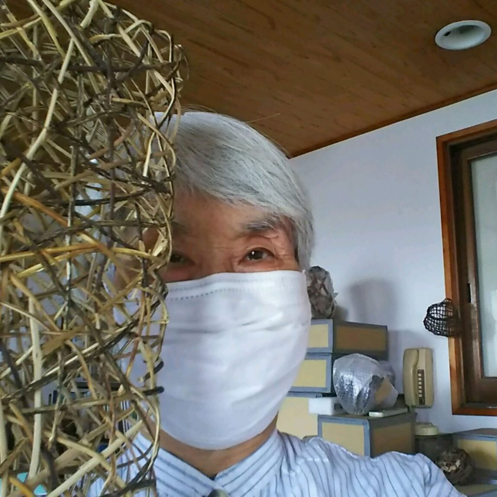 Hisako Sekijima at home wearing a mask