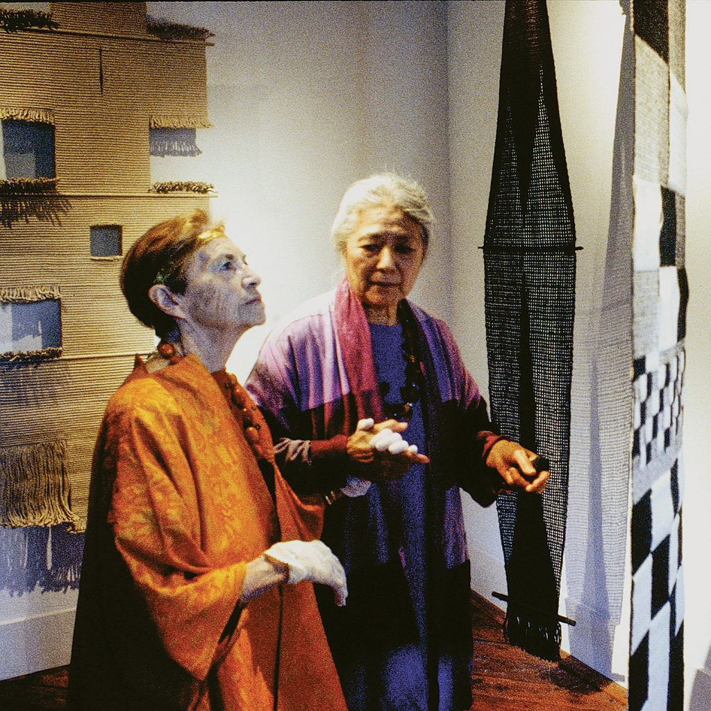 Lenore Tawney at her retrospective exhibition: Lenore Tawney: celebrating five decades of work touring the opening with her best friend Toshiko Takeazu in 2000. Photo by Tom Grotta