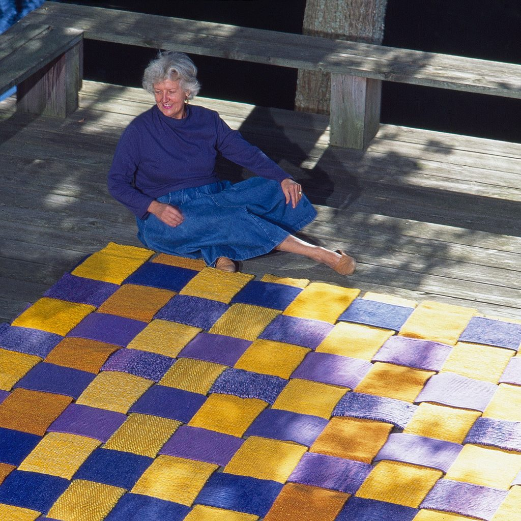 Sheila Hicks on her Conneticut deck. An outtake  from our catalog #13 Sheila Hicks, Joined by seven artists from Japan. Her work Chaine et trame interchangeable ( Interchangeable Warp and Weft)  is now in the permanent collection of the Dallas Museum of Art.  Photo By Tom Grotta
