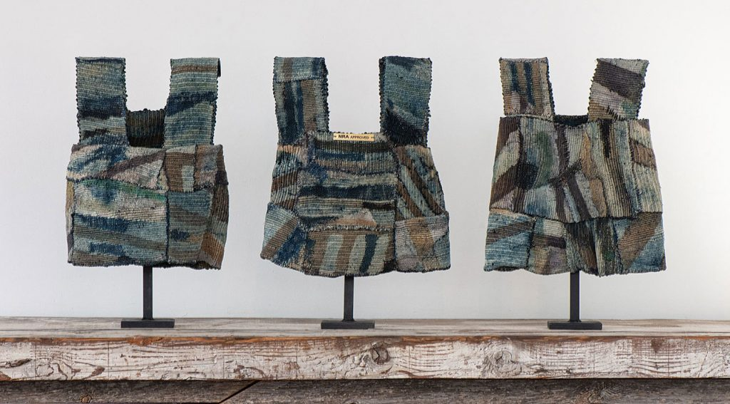 "NRA Approved,  James Bassler, woven, stitched and batik dyed; silk and sisal; each 20""h X 12""w X 4""d (as mounted), 3 pieces in one box  with 3 custom stands, 2014.Photo by Tom Grotta"
